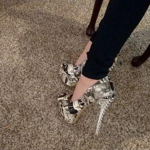 Extra sassy high fashion newsprint themed heels
